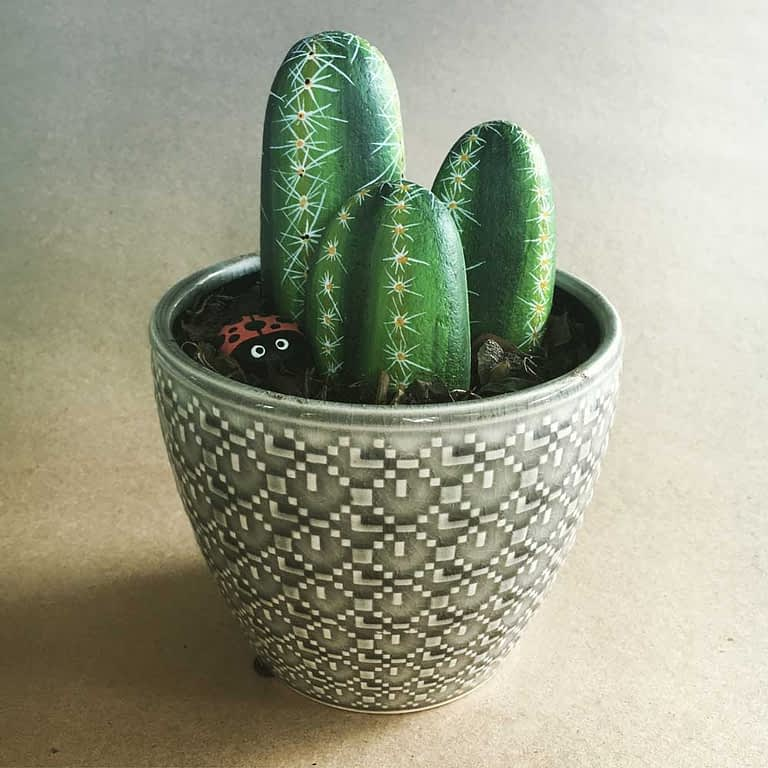 Rocks painted as cacti in a pot